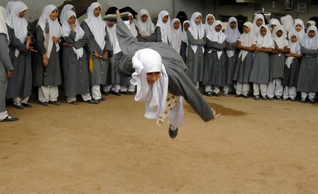 A Muslim schoolgirl from St. Maaz high school practises Chinese wushu martial arts inside the school compound in the southern Indian city of Hyderabad